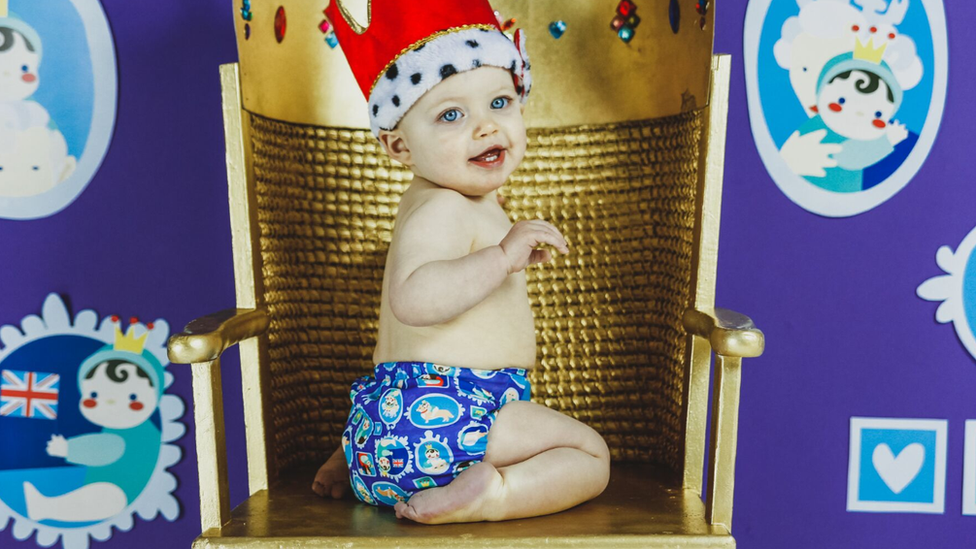 Baby wearing a nappy and a crown