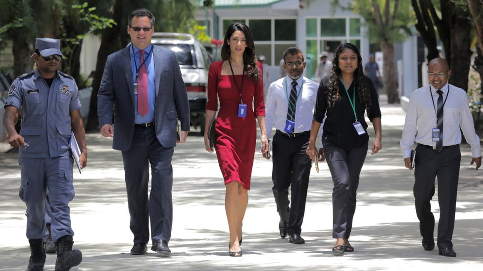 Human rights lawyer Amal Clooney (C) leaves the Maafushi Prison in Maafushi, some 27 km from the capital Male, on September 10, 2015.