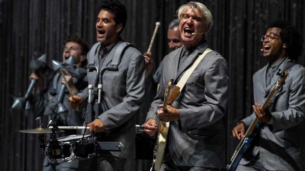 David Byrne performing with his band in Milan in 2018