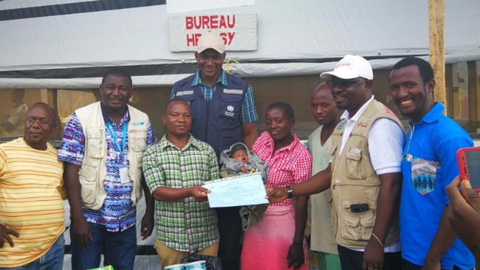 Baby Benedicte is taken home after surviving Ebola