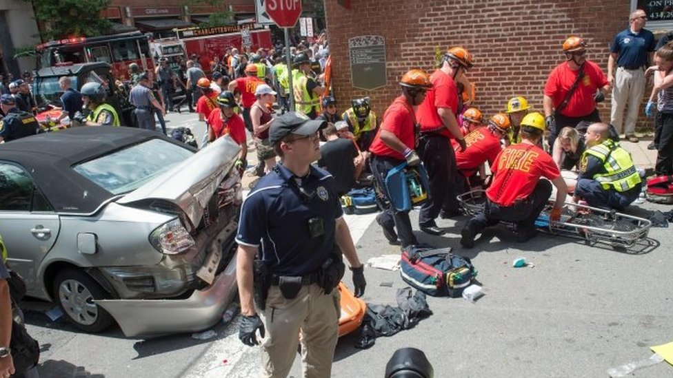 A woman is received first aid after a car accident ran into a crowd of protesters in Charlottesville, VA on 12 August 2017.