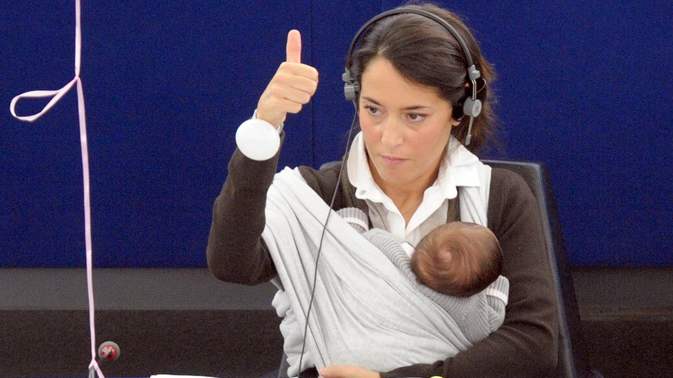 Licia Ronzulli sits with her baby daughter as she votes in the European Parliament in 2010