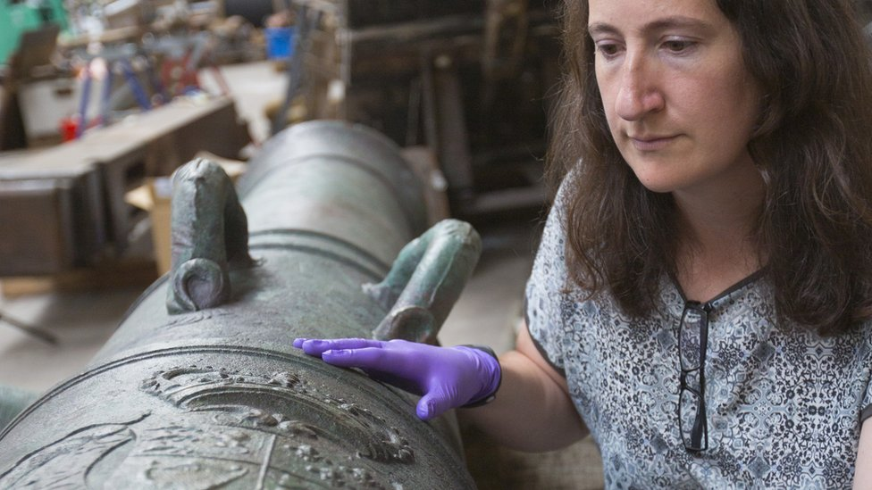 Diana Davis, senior conservator at The National Museum of the Royal Navy with one of Victory's cannon