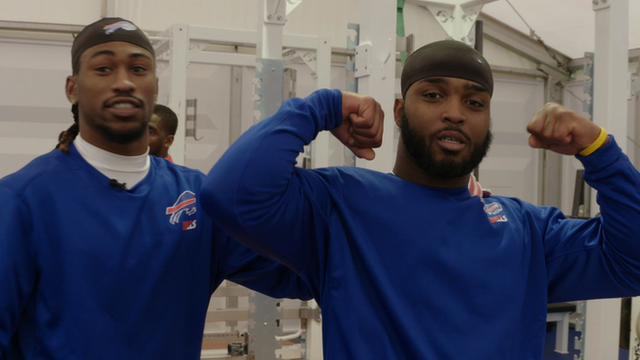 Ron Brooks (left) in the Buffalo Bills weight room