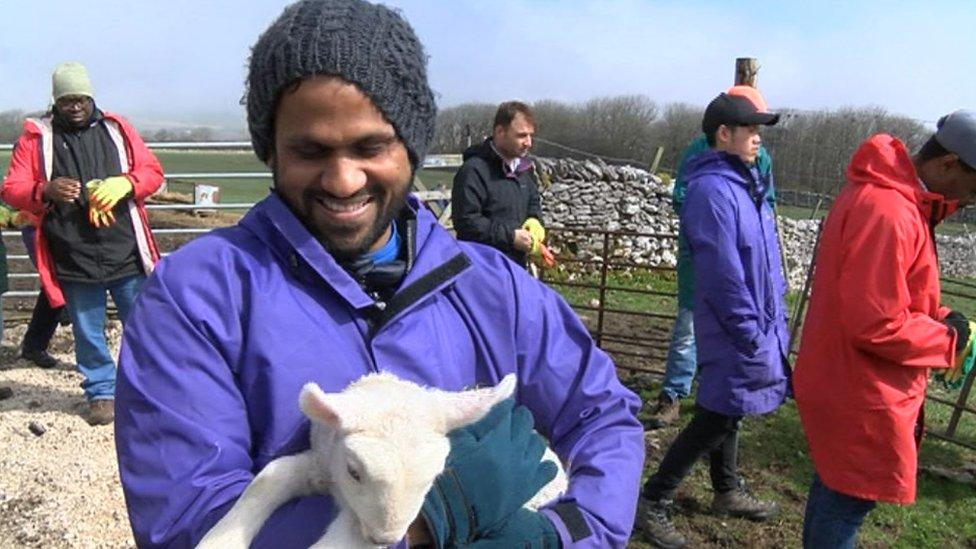 Eassa Malik with a lamb