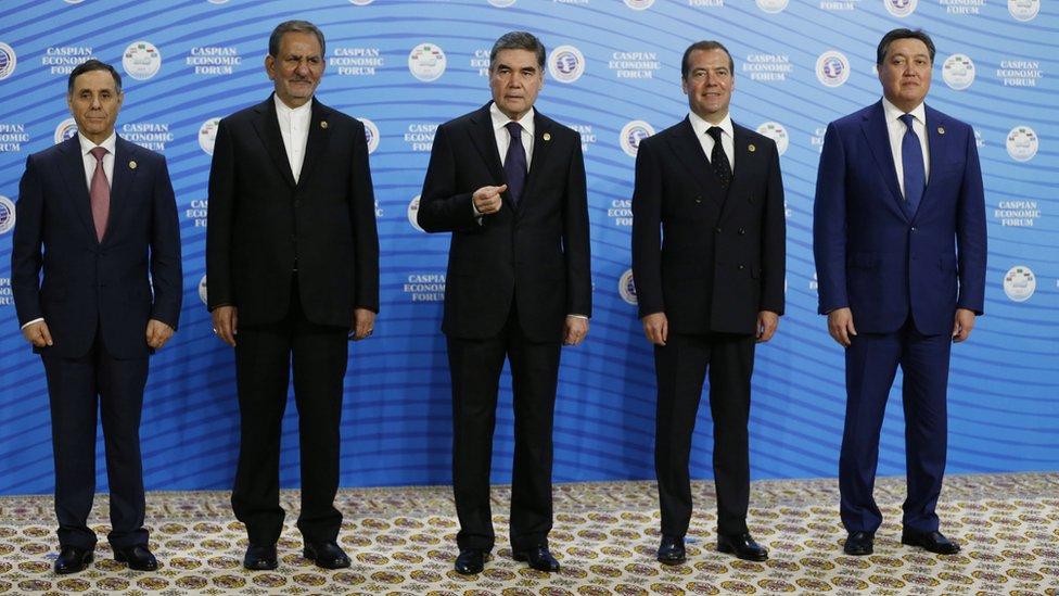 Mr Berdymukhamedov, centre, posing next to Azeri prime minister Novruz Mammadov, Iranian vice president Eshaq Jahangiri, Mr Medvedev, and Kazakh prime minister Askar Mamin at the Caspian Economic Forum