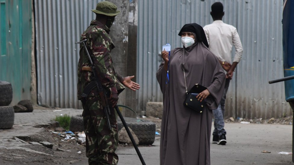 An officer suspect the identification of a person in a coronavirus hotspot in Nairobi
