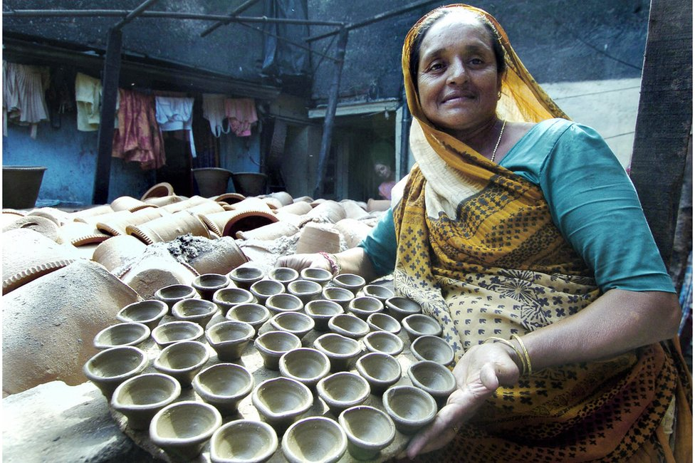 A potter with clay tea cups