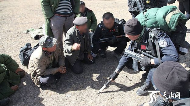 Chinese state media pictures show security forces searching a remote area of rugged terrain in Xinjiang