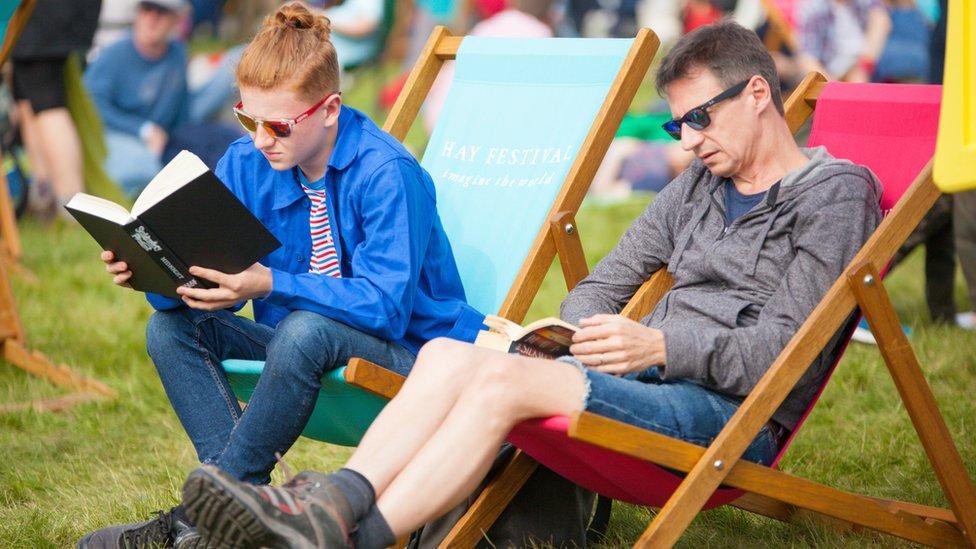 Two people reading at Hay Festival
