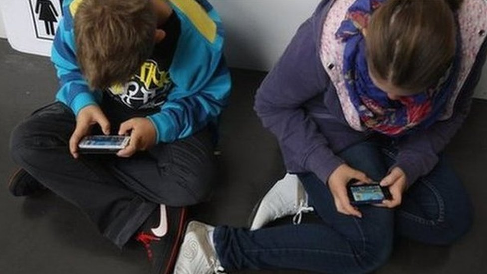 Children using mobile phones