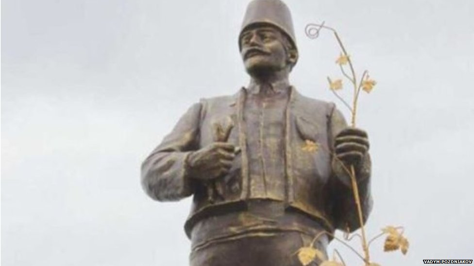 Statue of Lenin transformed with traditional Bulgarian attire