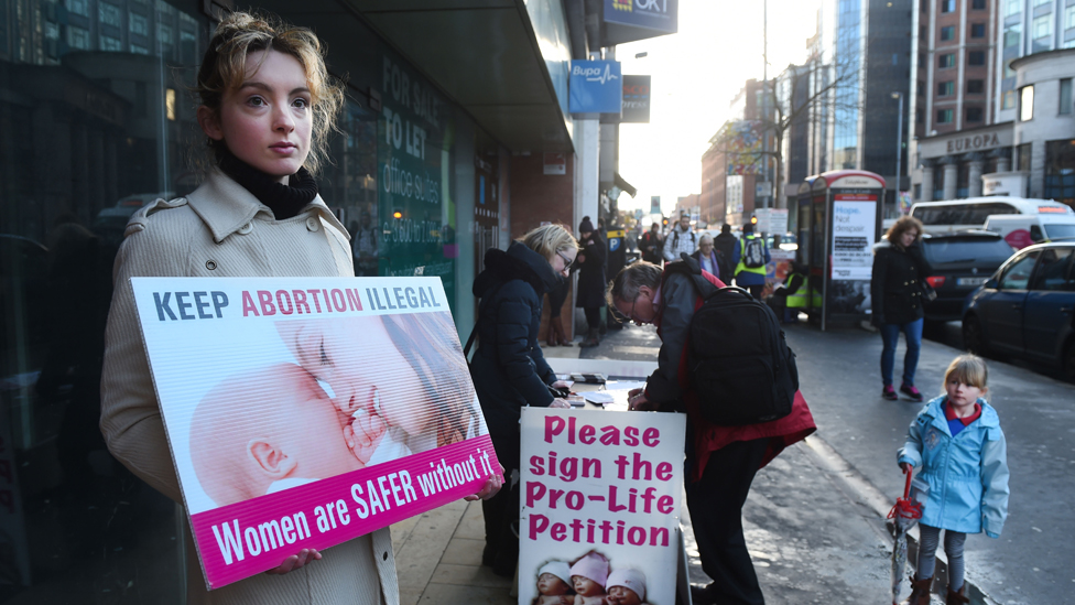 An anti-abortion activist outside the Marie Stopes Clinic on January 12, 2016 in Belfast, Northern Ireland.