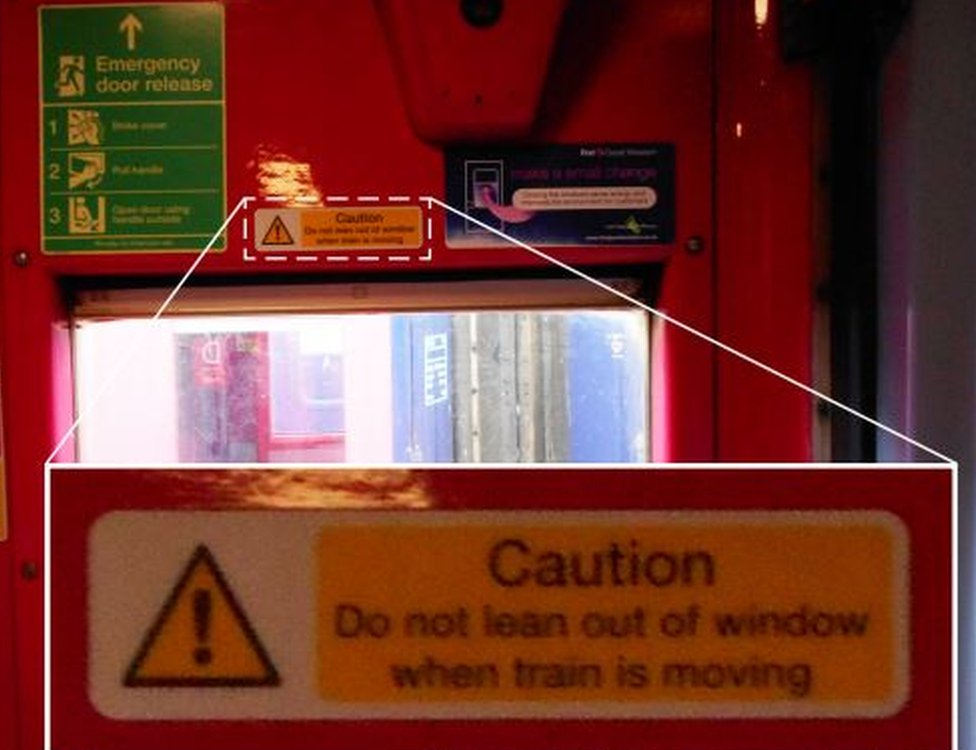 Warning sign by train window