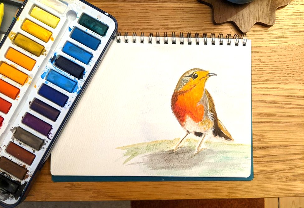 Paintbox with painting of a robin