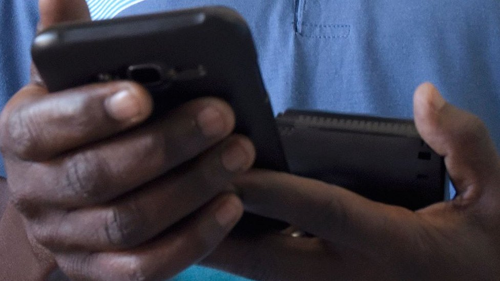 A man holding a mobile phone