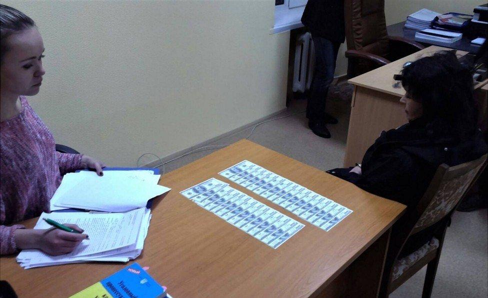 Teacher (right) under arrest in Ukraine