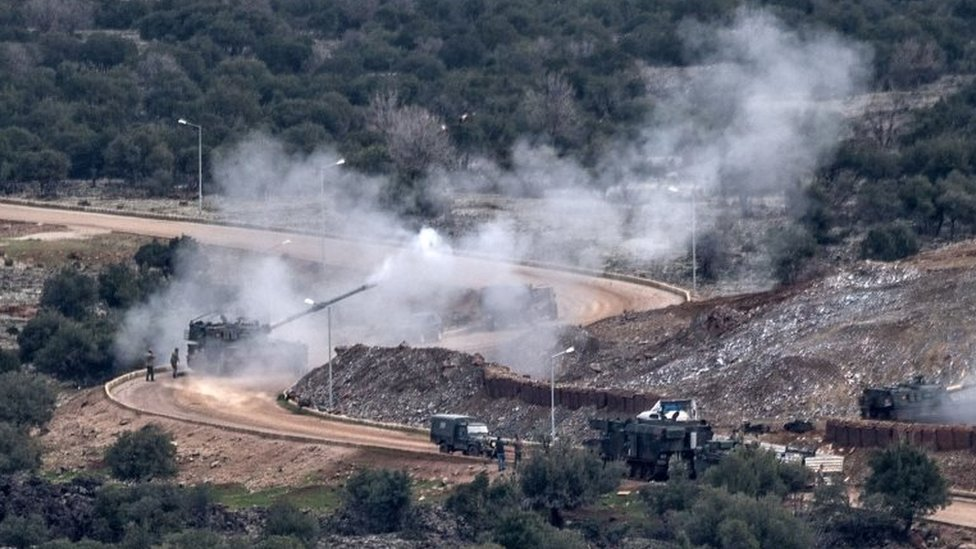 Turkish artillery shells the People's Protection Units (YPG) positions near the Syrian border on 21 January 2018 near Hassa,