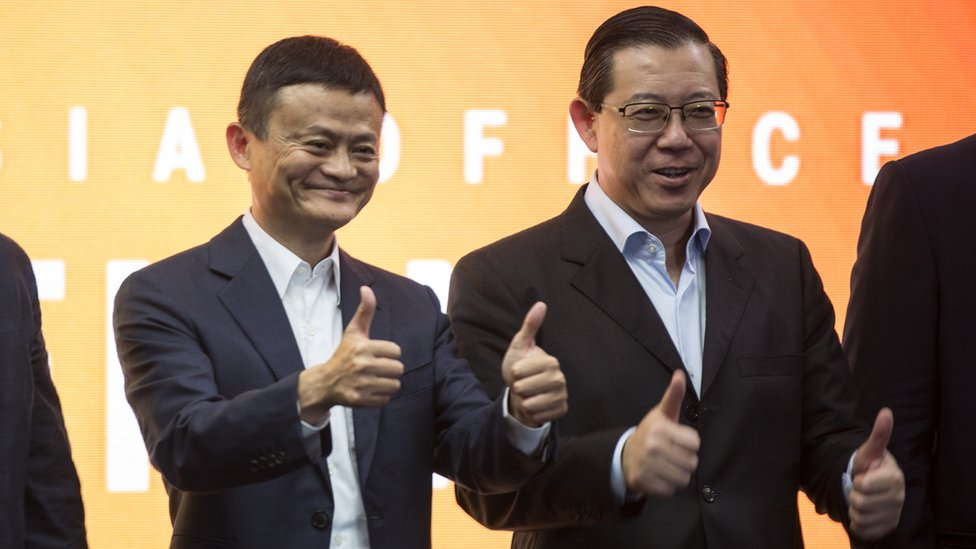 Jack Ma (L), the founder and executive chairman of Chinese e-commerce company Alibaba Group with Malaysian Fnance Minister, Lim Guan Eng (R) give the thumbs up during the opening of the Alibaba group office in Kuala Lumpur, Malaysia, 18 June 2018.