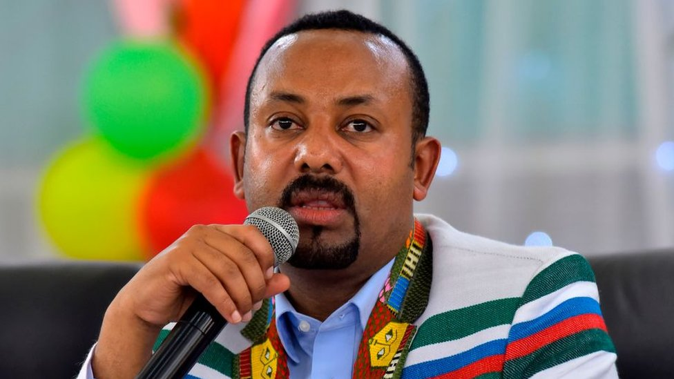 Ethiopian Prime Minister Abiy Ahmed, wearing a white coat with the traditional Kafficho colors red, green and blue, speaks to the audience in Bonga, the capital of Kaffa province, approximately 449 km southwest of the capital Addis Ababa, on 15 September 2019