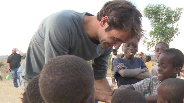 Roger Federer meeting children in Malawi
