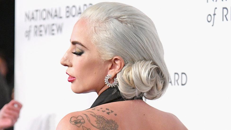 Lady Gaga 'appalled' by music tattoo error