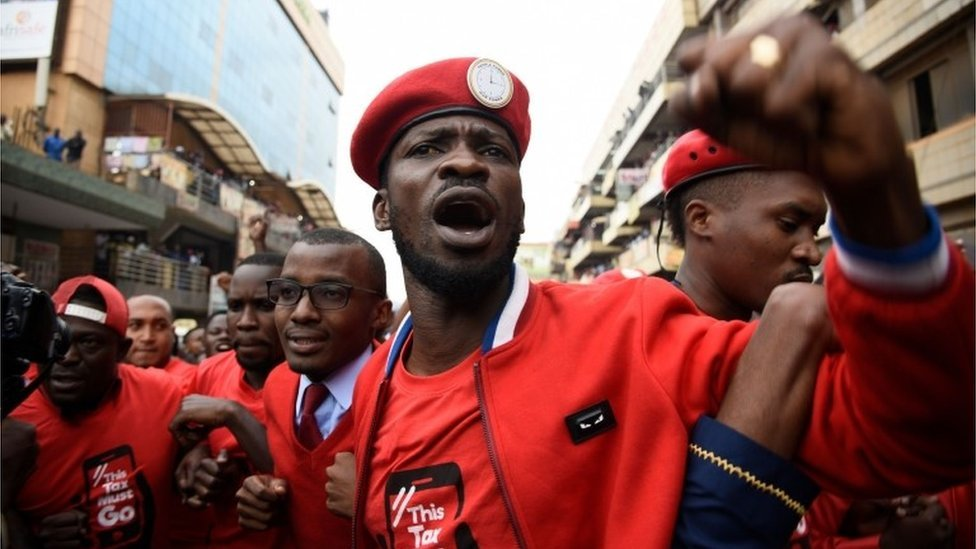 Robert Kyagulanyi (C) is joined by other activists in Kampala on July 11, 2018 in Kampala during a demonstration to protest a controversial tax on the use of social media.