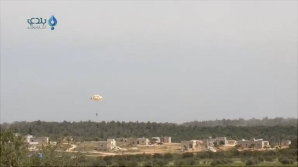 Frame from a video purporting to show the pilot parachuting after his plane was brought down