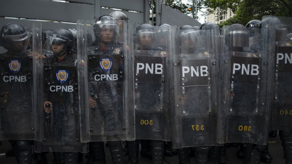 A large group of Venezuelan National Police officers block a street during a demonstration against the government of Nicolas Maduro organized by supporters of Juan Guaido on March 10, 2020 in Caracas, Venezuela