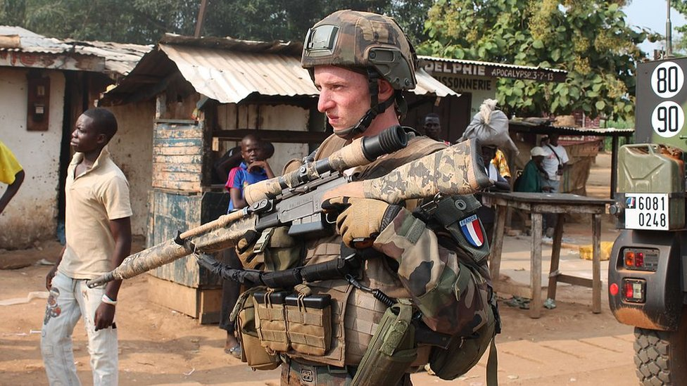 A French soldier of the the 'Sangaris Operation' standing guard