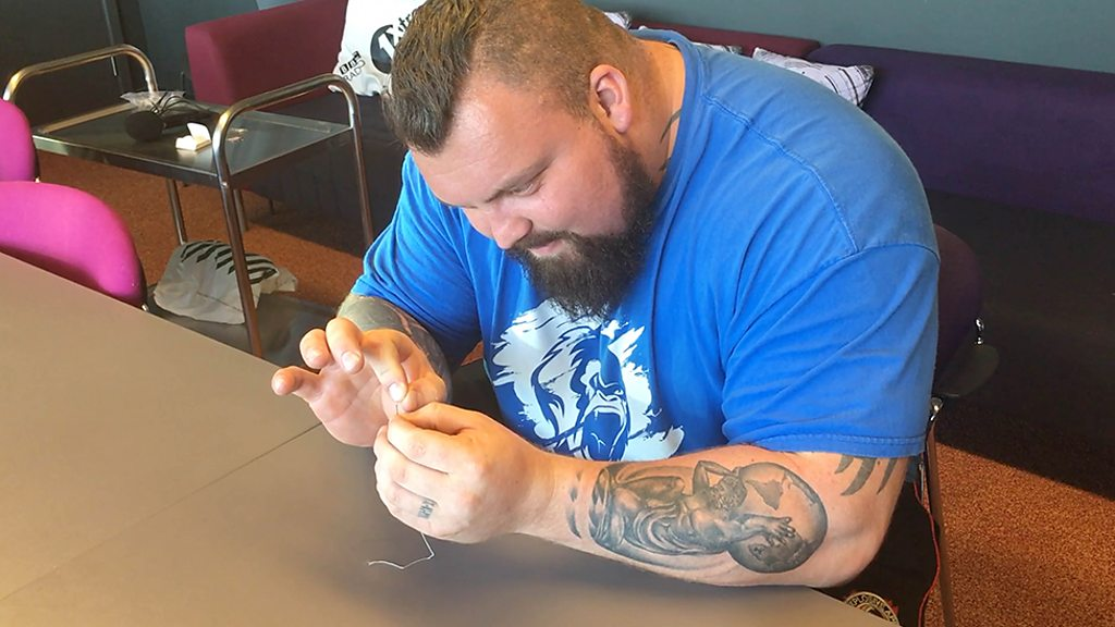Eddie Hall: Record-breaking strong man does delicate tasks