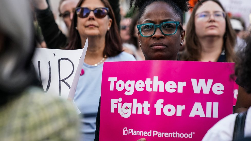 Abortion-rights campaigners attend a rally against in New York City
