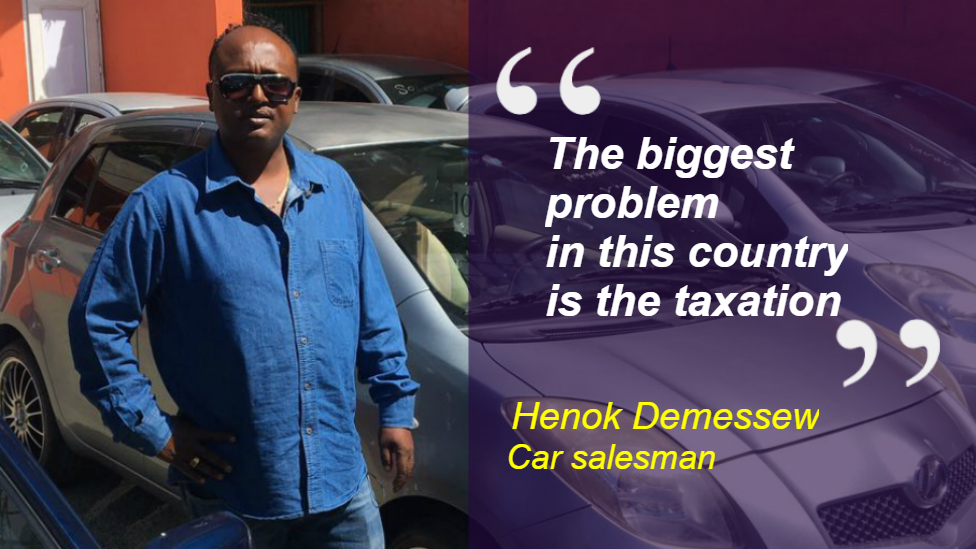 """Henok Demessew at his car sales business in Addis Ababa, Ethiopia. Quote: """"The biggest problem in this ocuntry is the taxation"""""""