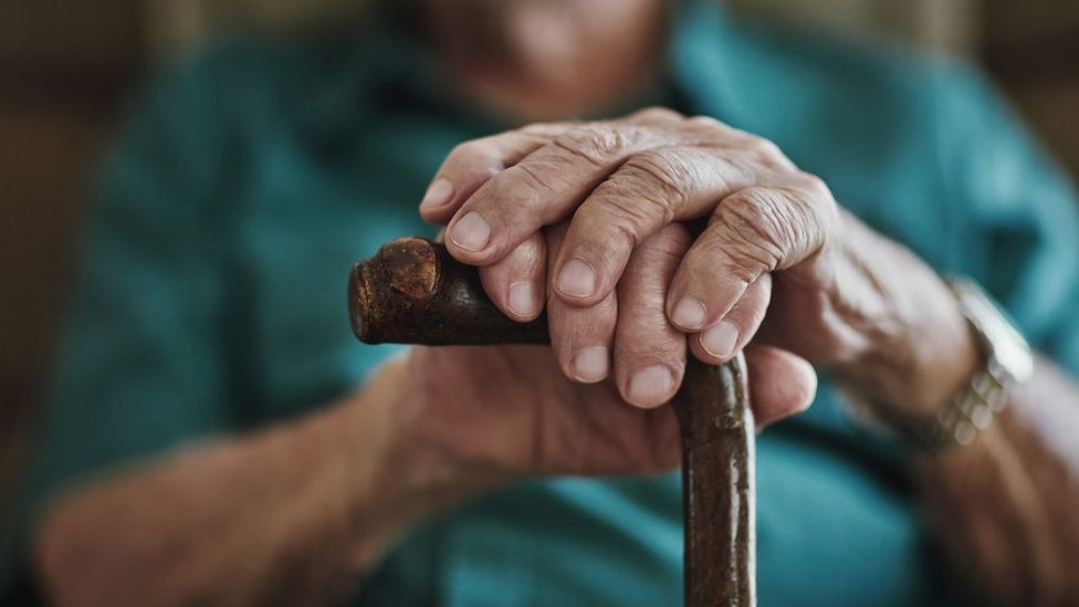 Elderly person with stick