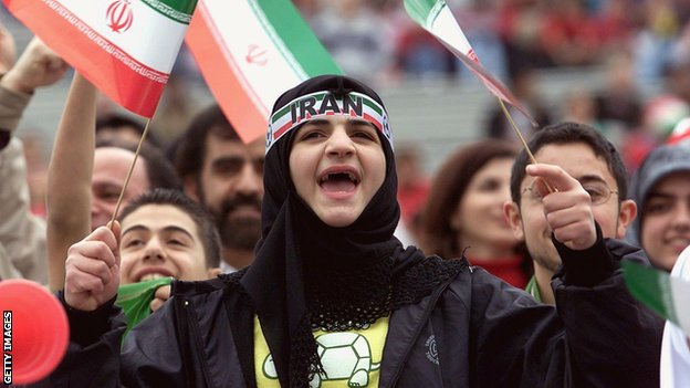 A female Iranian fan watches her team take on the USA, in the 2000 friendly match played in Pasadena