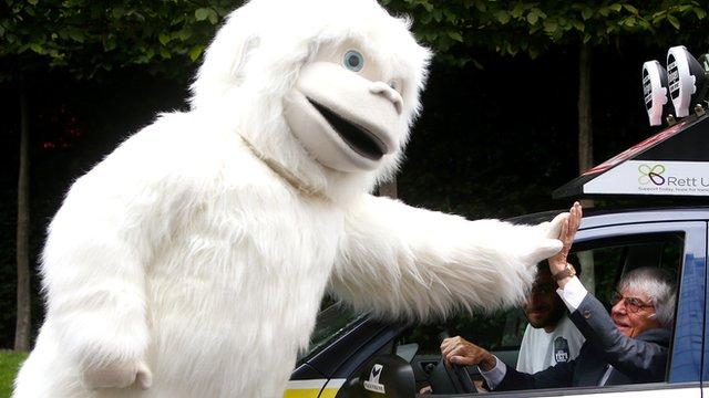 Bernie Ecclestone high-fives a yeti