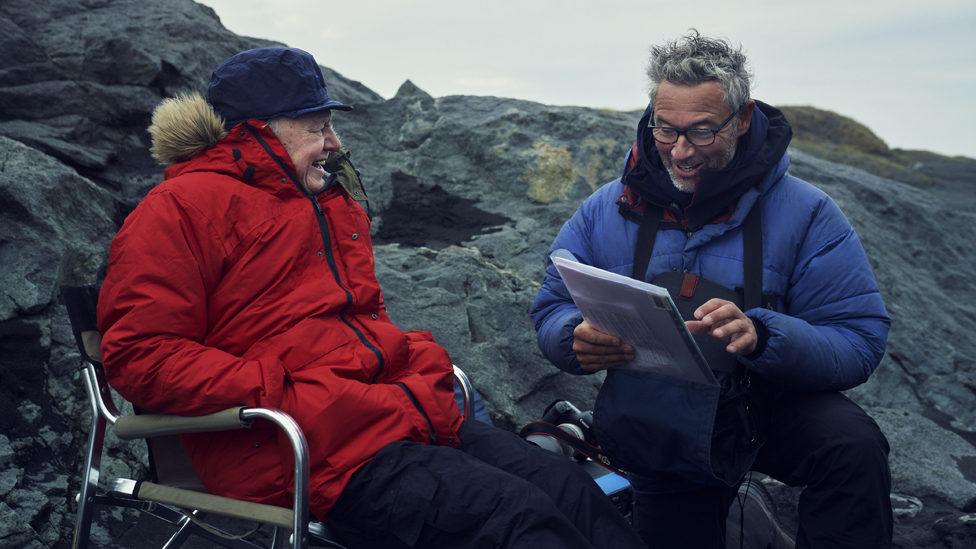 Sir David Attenborough and director Jonny Keeling discuss the script while filming in Iceland