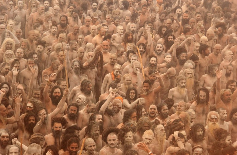 Sadhus going to take a dip in the Ganges