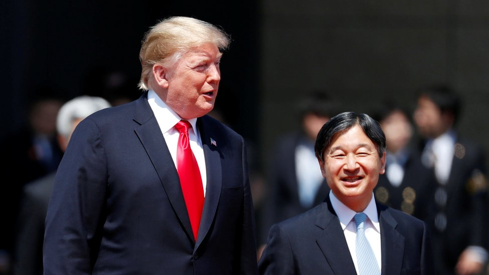 "U.S. President Donald Trump is escorted by Japan""s Emperor Naruhito during an welcome ceremony at the Imperial Palace in Tokyo, Japan"