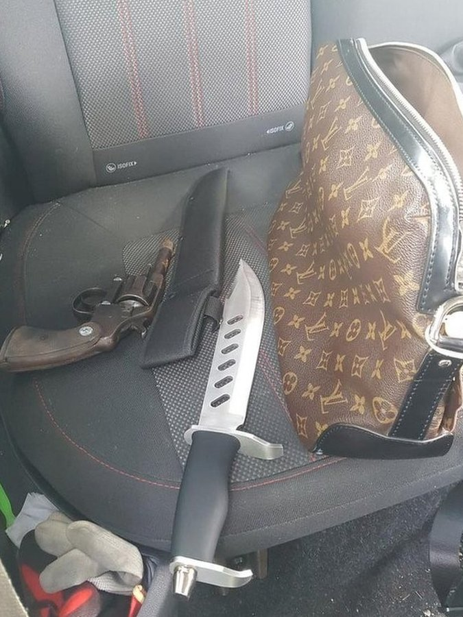 Designer handbag, a knife and a handgun on a car seat