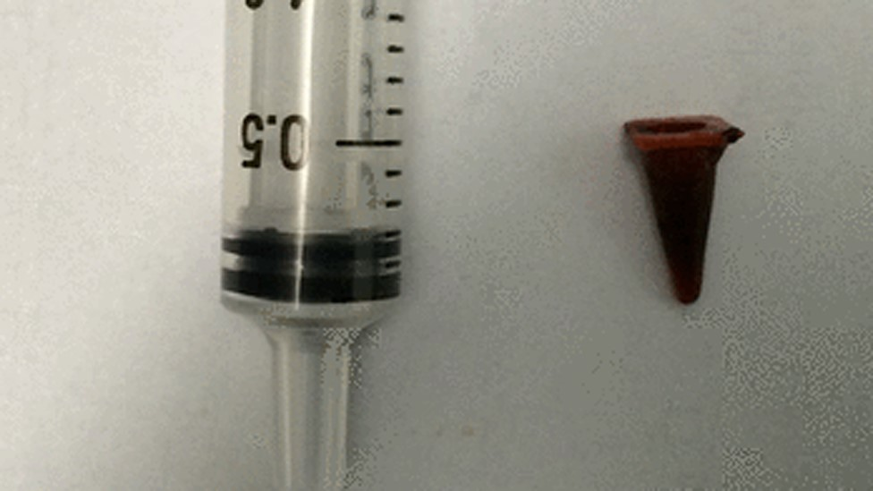 syringe and toy cone