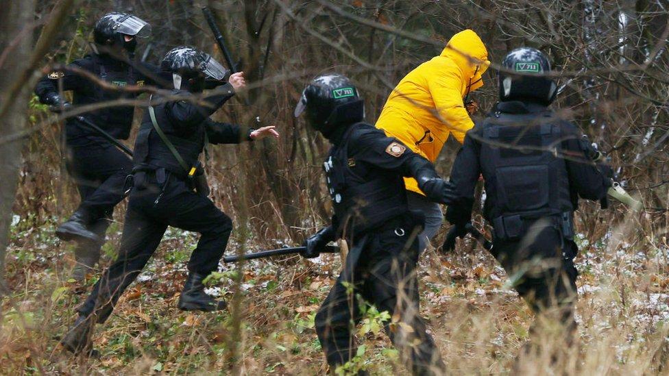 Police chase a demonstrator in Belarus on 22 November