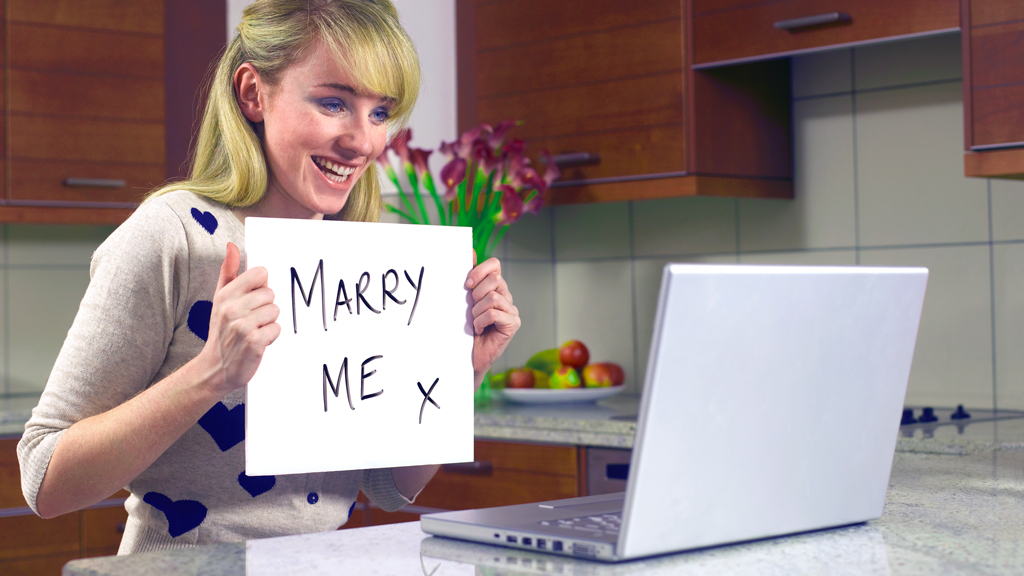 Woman proposing marriage via laptop