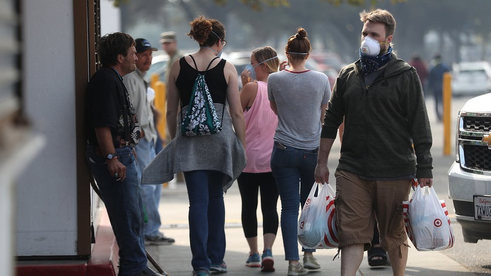 Evacuees wear masks to protect themselves from inhaling smoke