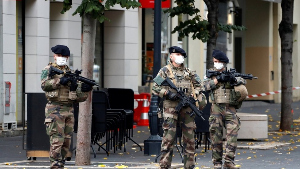 Special forces stand guard near the scene of the attack