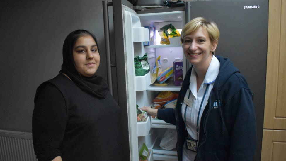 Bradford paediatric dietitian Alison Woodhead helping to clear junk food from a fridge with Maryam, 14