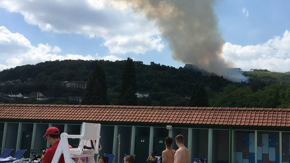 Firefighters busy with grass fires