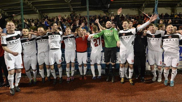 Crusaders team celebrate winning the Irish Premiership with a 3-1 victory over Cliftonville at Solitude