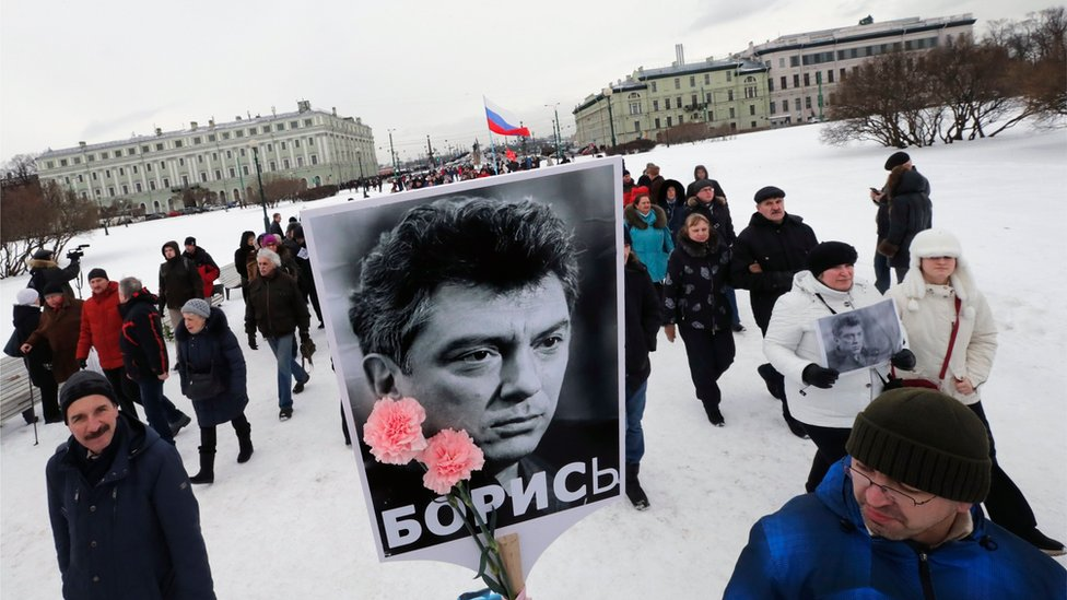 Russian people participate in a memorial march for Boris Nemtsov in St Petersburg
