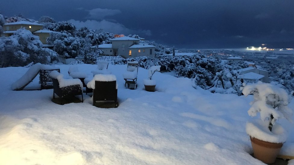 A house garden covered with snow near Ajaccio on the French Mediterranean island of Corsica